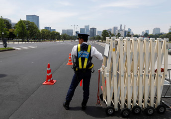 A police officer stands guard on a street near a hotel where U.S. President Donald Trump and first lady Melania Trump are staying, in Tokyo