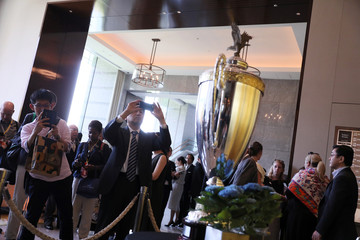 People take pictures with The President's Cup, which U.S. President Trump will present to the winner of a sumo wrestling tournament, is on display at the Palace Hotel in Tokyo