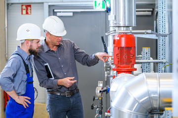 boss with worker in factory