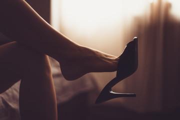 sexy woman legs in high heel mules. women fetish shoe dangling on feet. shoeplay, shoe and foot fetish. beautiful woman flirting. woman's heel slippers