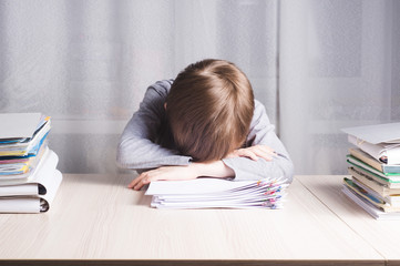 picture of schoolboy sleeping at home in funny pose