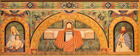 Wall Mural - BELAGGIO, ITALY - MAY 10, 2015: The paint on the main altar on the wood - Jesus on the corss with Madonna and St. Joseph in church Chiesa di San Giacomo  from 20. cent.