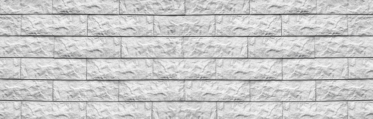 Wide white cement tile wide texture. Whitewashed stone block masonry panoramic background. Rough...