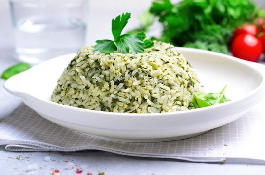 Spinach Rice on a Plate over Bright Background
