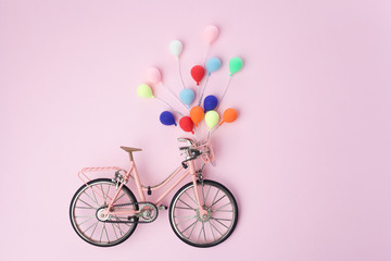 Fotobehang Fiets Colorful balloon hang the pink bicycle vintage on pink pastel background. idea of love. Minimal love concept.