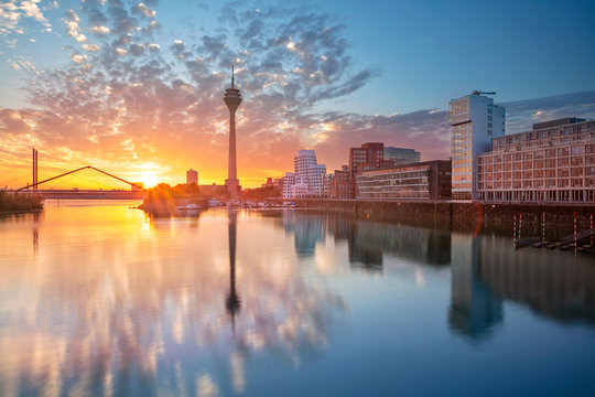Dusseldorf, Germany. Cityscape image of Düsseldorf, Germany with the Media Harbour and reflection of the city in the Rhine river, during sunrise.