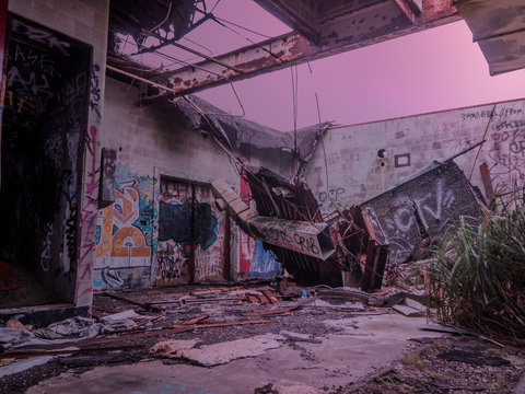Abandoned Building Site In Foggy Purple Sunset Covered in Graffiti and Tags