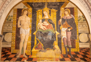 Wall Mural - COMO, ITALY - MAY 8, 2015: The fresco of Madonna with the saints Sebastian de Roch in church Basilica di San Fedele by Andreas de Magistris 1504.