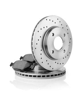 Brake discs and brake pads on white background