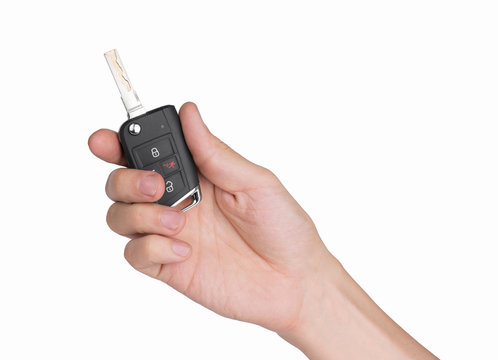 Hand holding car keys isolated