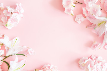 Flowers composition. Pink and white flowers on pastel pink background. Flat lay, top view, copy space