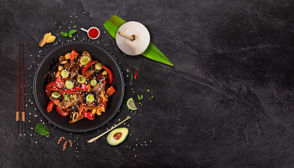 Szechuan beef asian food background with various ingredients on rustic stone background , top view. Vietnam or Thai cuisine. - fototapety na wymiar