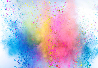 Colored powder explosion on white background. Freeze motion. Wall mural