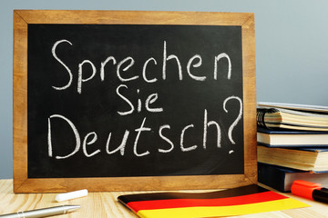 Sprechen Sie Deutsch written on a blackboard. Learn German concept.