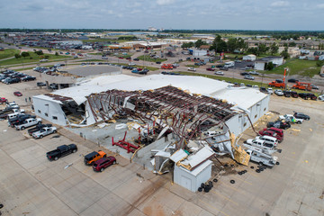 Damage to the Frontier Chevrolet car and truck dealership is seen in an aerial photo after a tornado touched down overnight in El Reno