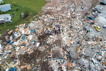 Emergency personnel search an area of destruction after a tornado touched down overnight in an aerial photo in El Reno