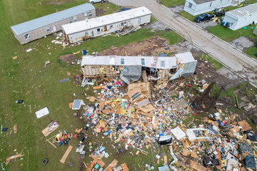 Debris covers an area in a mobile home park after a tornado touched down overnight, in an aerial photo in El Reno