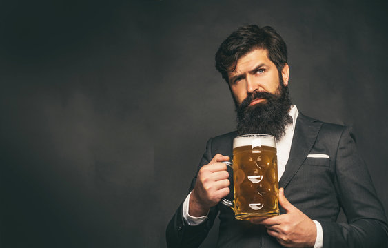 Beer pubs and bars. Enjoy in pub. Retro man in black suit with a beer. Retro advertising of alcoholic beverages.