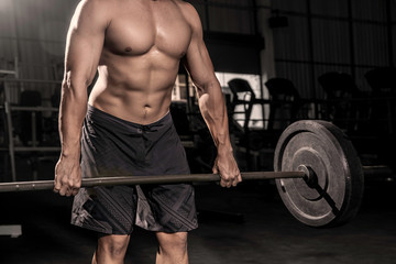 Close up of hands Handsome strong athletic men pumping up muscles workout barbell curl bodybuilding concept background - muscular bodybuilder men doing exercises in dark gym .