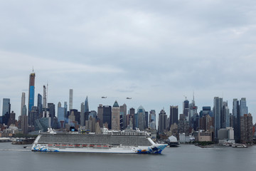 A cruise liner sails past the skyline of New York City,New York