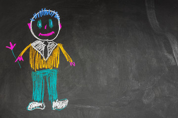 children's picture of happy daddy made with chalk on blackboard