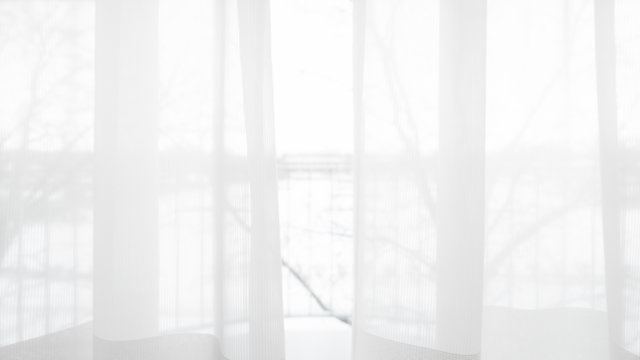Blur curtain window and stationery box with sunlight.