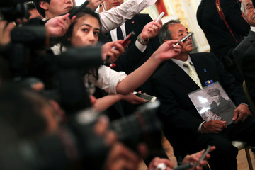 Members of the media work next to family members of people abducted by North Korea, during their meeting with U.S. President Donald Trump at Akasaka Palace in Tokyo