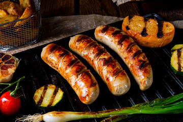 Delicious  grilled sausage with various grilled vegetables Wall mural