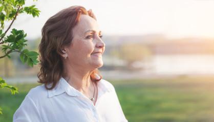 Beautiful happy smiling elderly woman closeup portrait, happy pension concept.