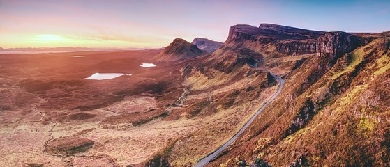 Spring view of Quiraing mountains with blue sky, Isle of Skye. Sharp rocky mountains above vallley. Wall mural