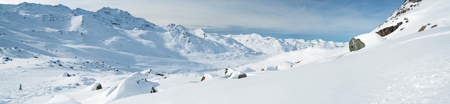 Panoramic view across snow covered alpine mountain range
