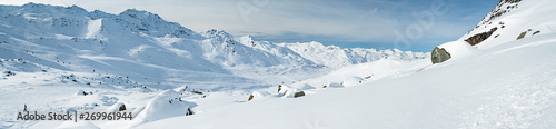 Wall mural Panoramic view across snow covered alpine mountain range