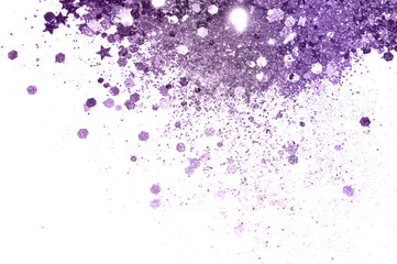 Purple glitter and glittering stars on white background in vintage colors