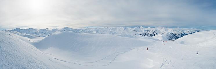 Wall Mural - Panoramic view across snow covered alpine mountain range
