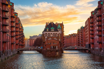 The Warehouse district Speicherstadt during sunset in Hamburg, Germany. Old warehouses in Hafencity quarter in Hamburg. Wall mural