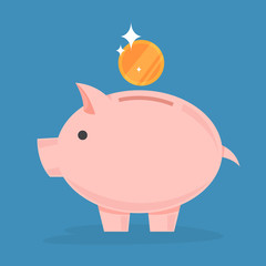 Golden coin falling in the piggy bank. Idea of economy