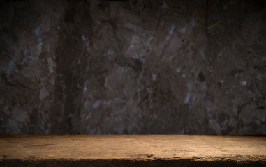 Old wooden table with brick background dark
