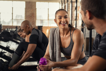 Fitness woman relaxing in gym after workout session