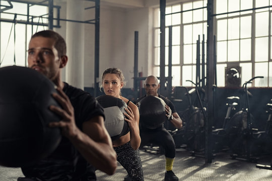 Fitness class using heavy weight balls