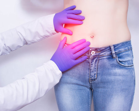 The doctor conducts a visual inspection and palpation of the patient s abdomen on suspicion of acute apendicitis and inflammation, abdominal pain, medical