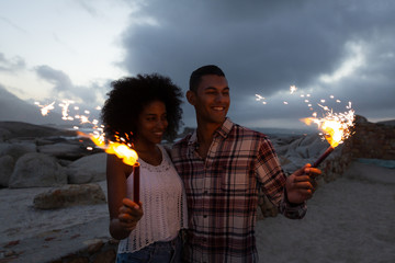 Couple enjoying with fire cracker on the beach