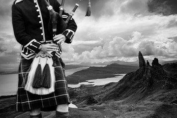 Traditional scottish bagpiper in full dress Wall mural