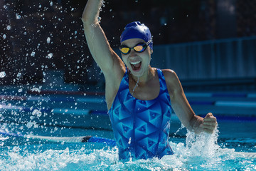 Female swimmer having fun in swimming pool