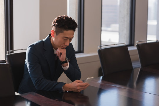 Man using mobile phone in the conference room