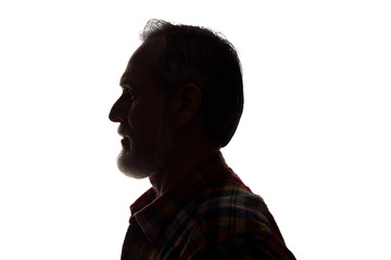 Portrait of a old man, side view - dark close-up silhouette