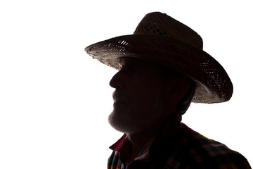 Old man in cowboy hat, side view - dark close-up silhouette