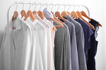 Rack with stylish clothes in room Wall mural