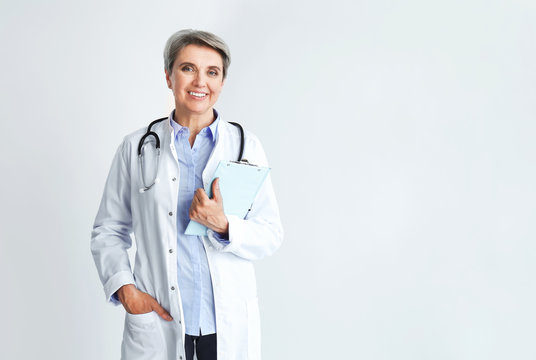 Mature female doctor on light background
