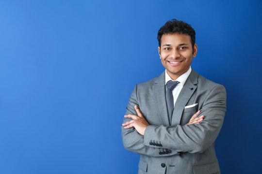 Handsome businessman on color background