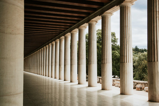 Greek architecture columns in a row. Ancient stone pillars.